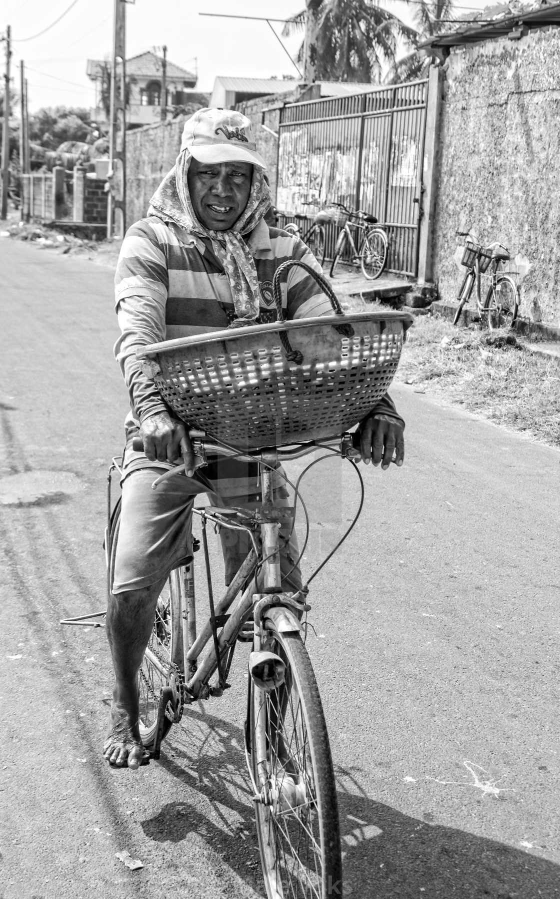 """Fisherman cycles with fish basket"" stock image"