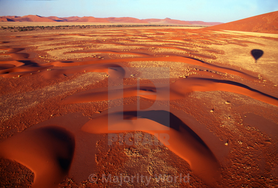 """view over a valley of sand dunes from a hot air balloon trip just after..."" stock image"