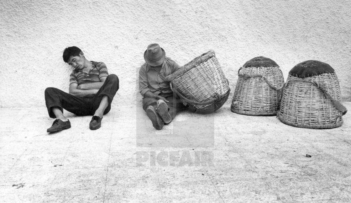 """ECUADOR FISHERMEN RESTING AFTER A LONG NIGHT SHIFT, GUAYAQUIL 1990"" stock image"