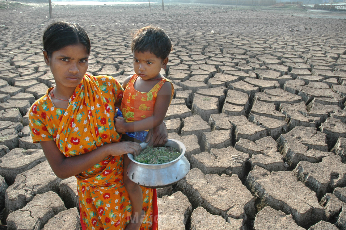 """""""A young girl and her sister from the below poverty level group, at the dried..."""" stock image"""