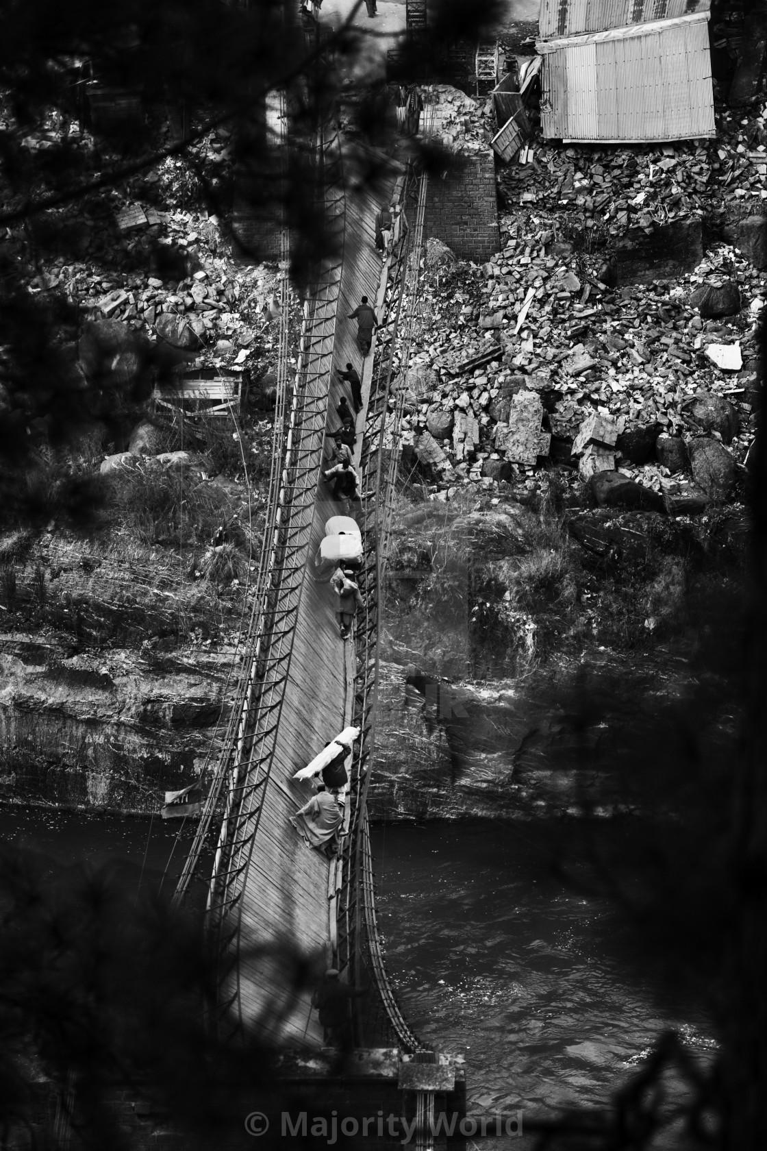 """Despite obvious transportability dangers, the broken bridge over river Neelum..."" stock image"