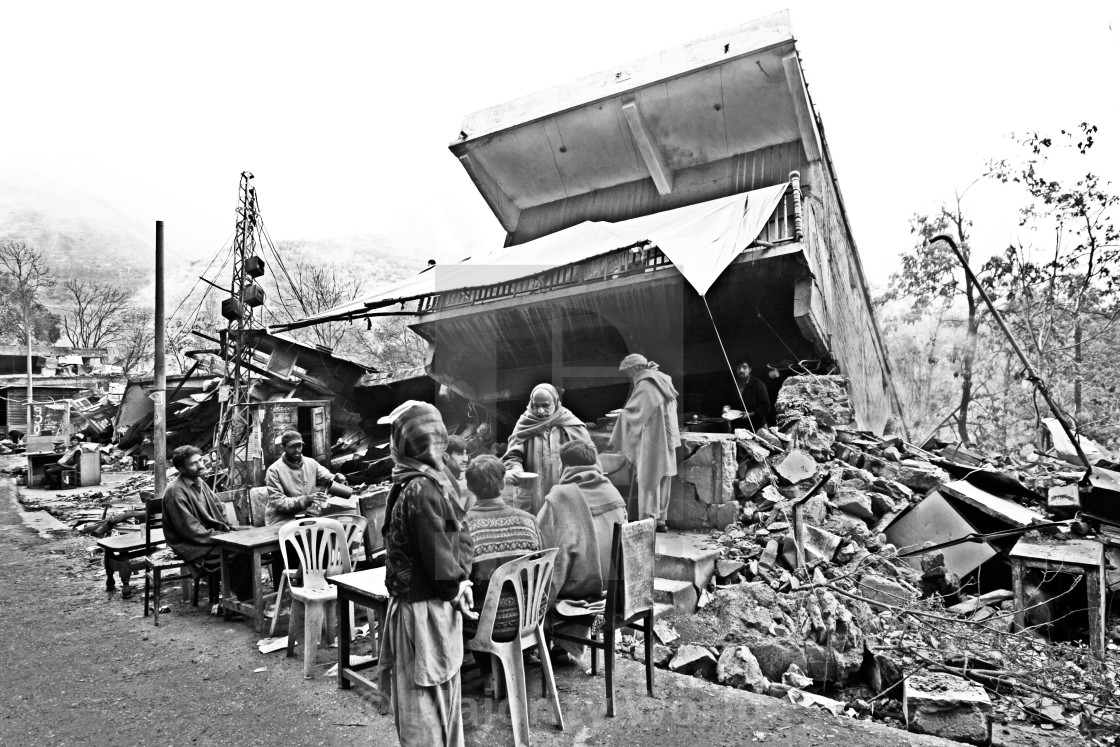 """""""Not far from the river Neelum, a demolished restaurant is open for business..."""" stock image"""
