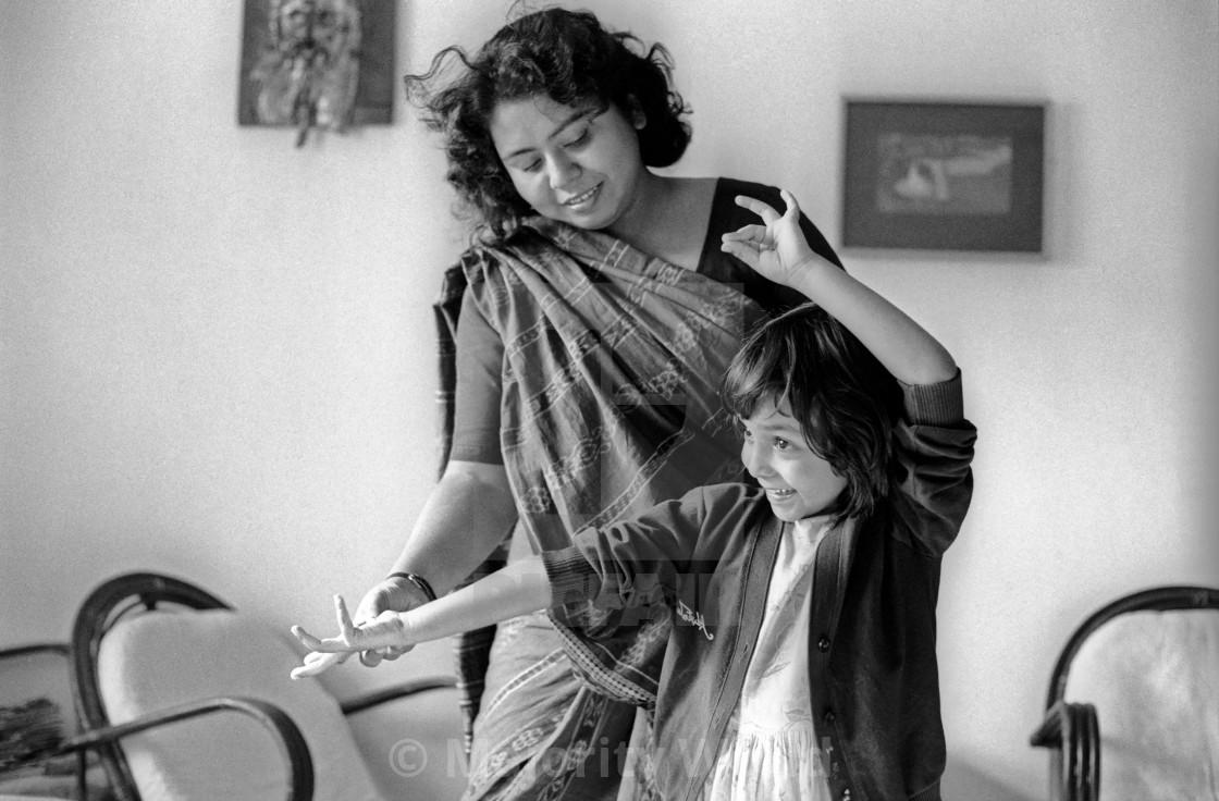 """A woman teaches a girl how to dance. Dhaka, Bangladesh."" stock image"