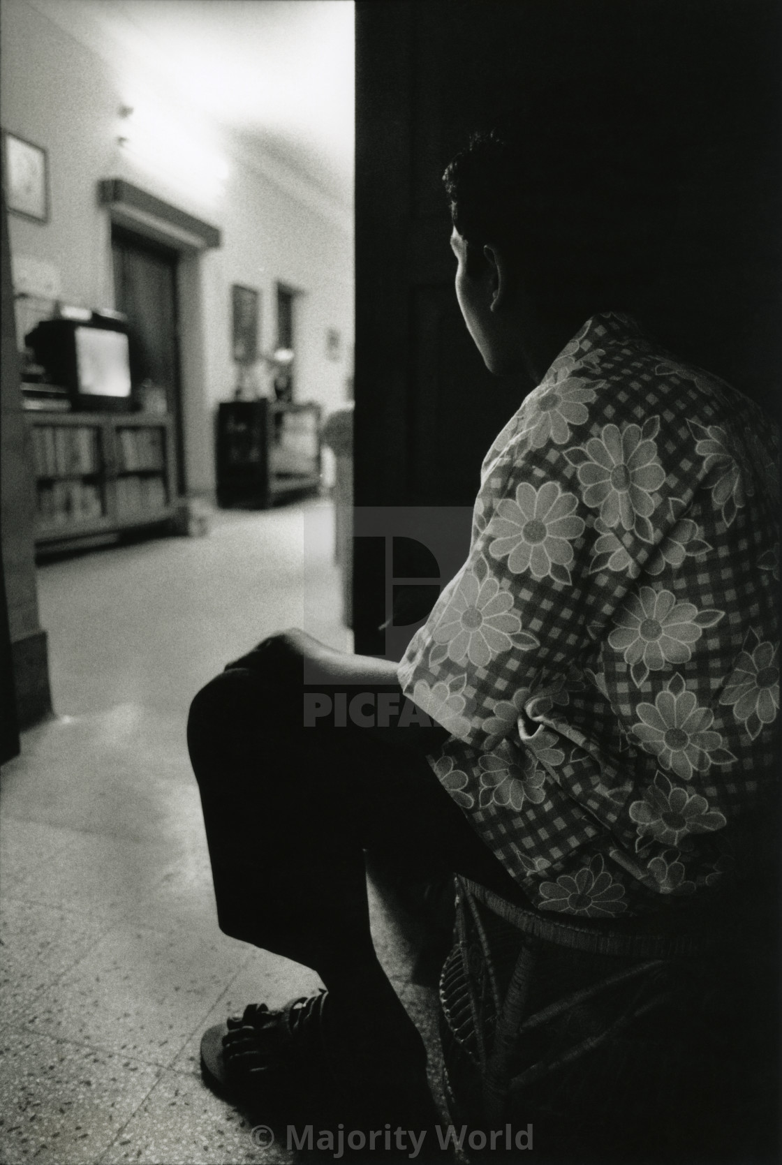 """Mizan, a young boy watching television, sitting by the door. He can enter the..."" stock image"