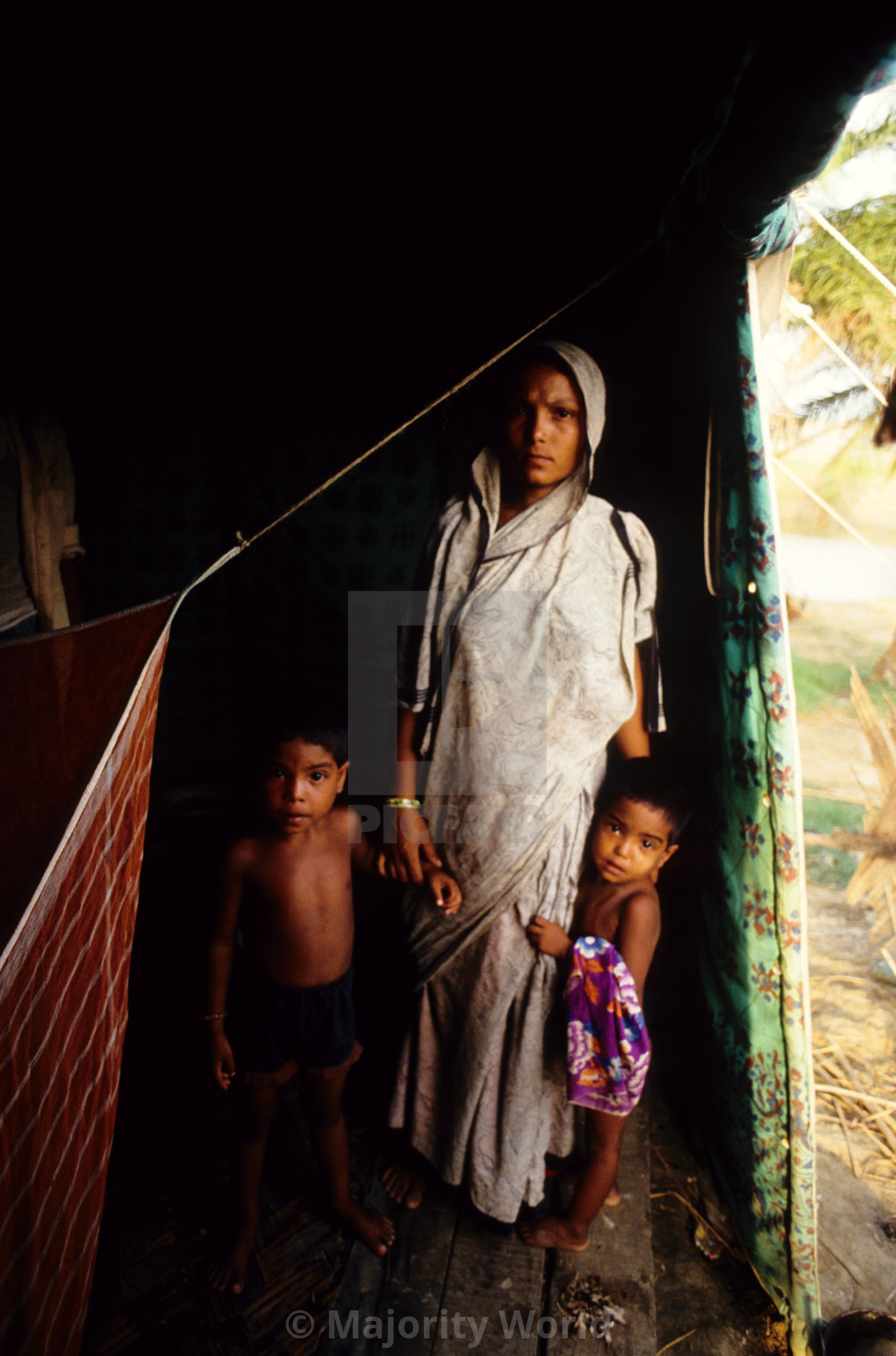 """""""A mother and her children; survivors of the 1991 cyclone. The 1991 cyclone..."""" stock image"""