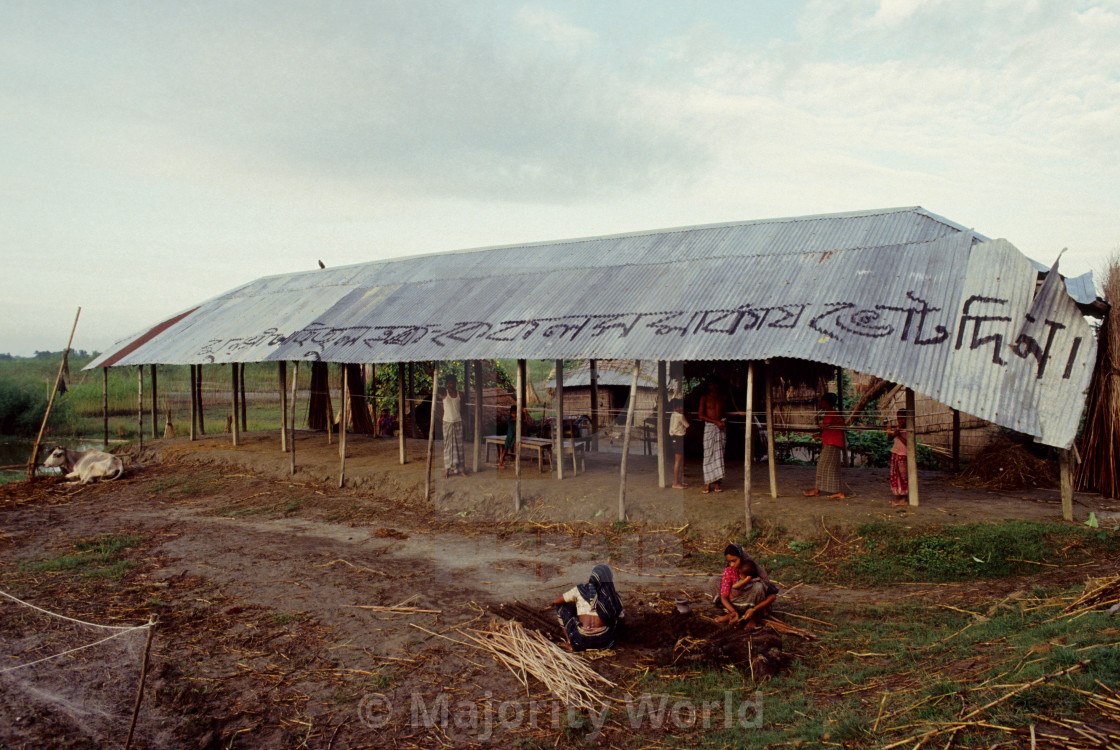 """""""Villagers re building a home after the cyclone, in a village, in Banshkhali..."""" stock image"""