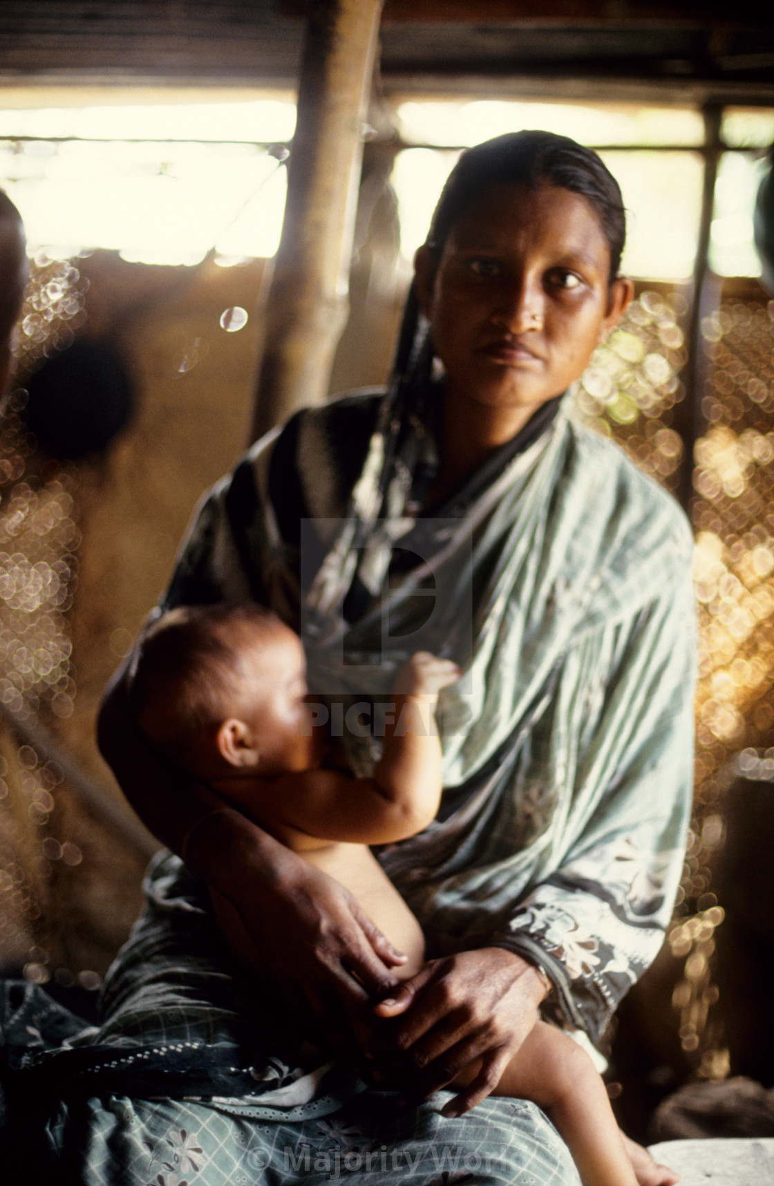 """A mother and her child; survivors of the 1991 cyclone. The 1991 cyclone was..."" stock image"