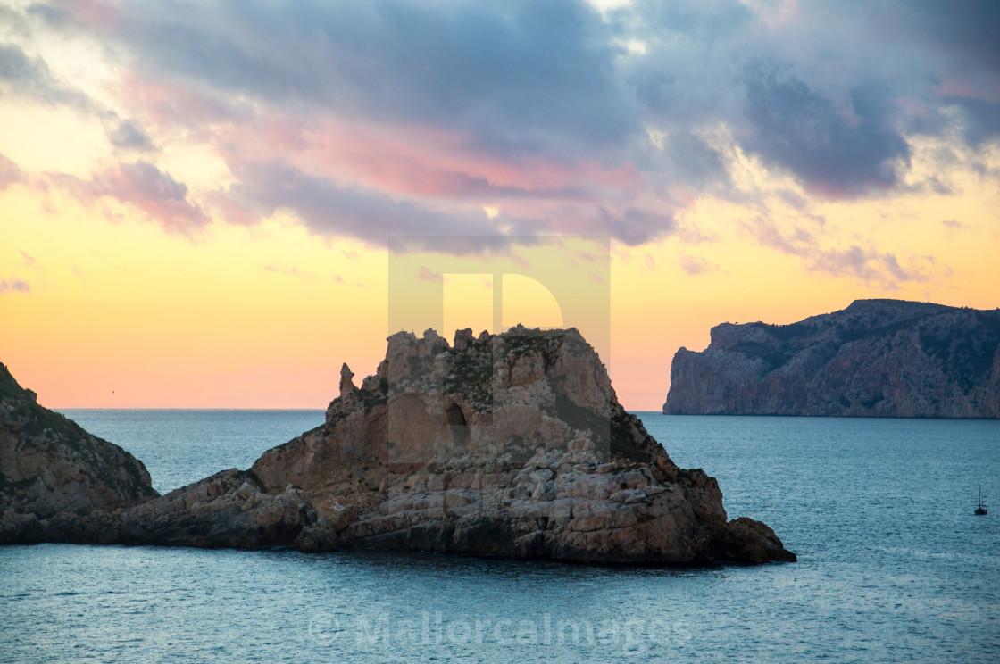 """Winter sunset at Es Malgrat islands Mallorca in February."" stock image"