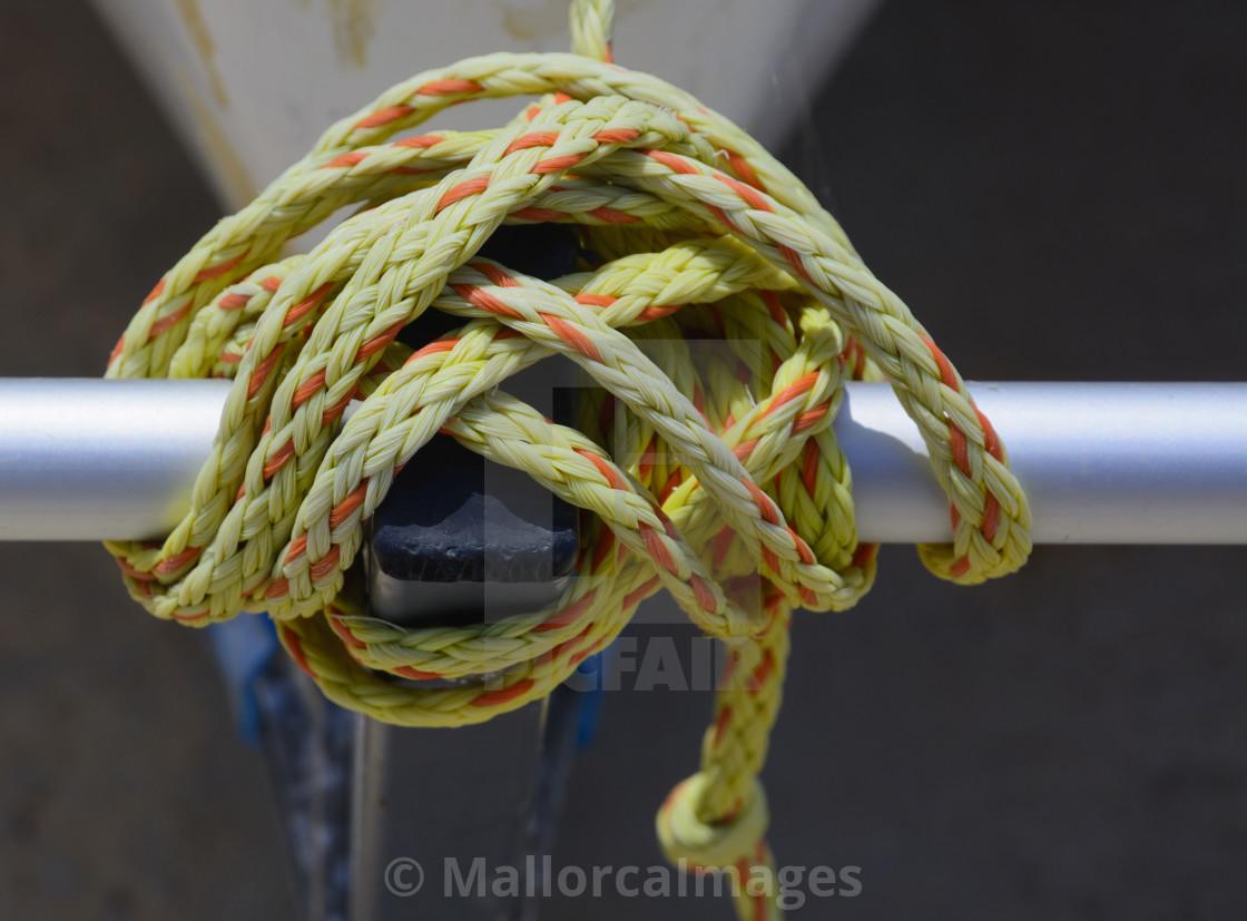 """Knot in yellow and orange nylon"" stock image"