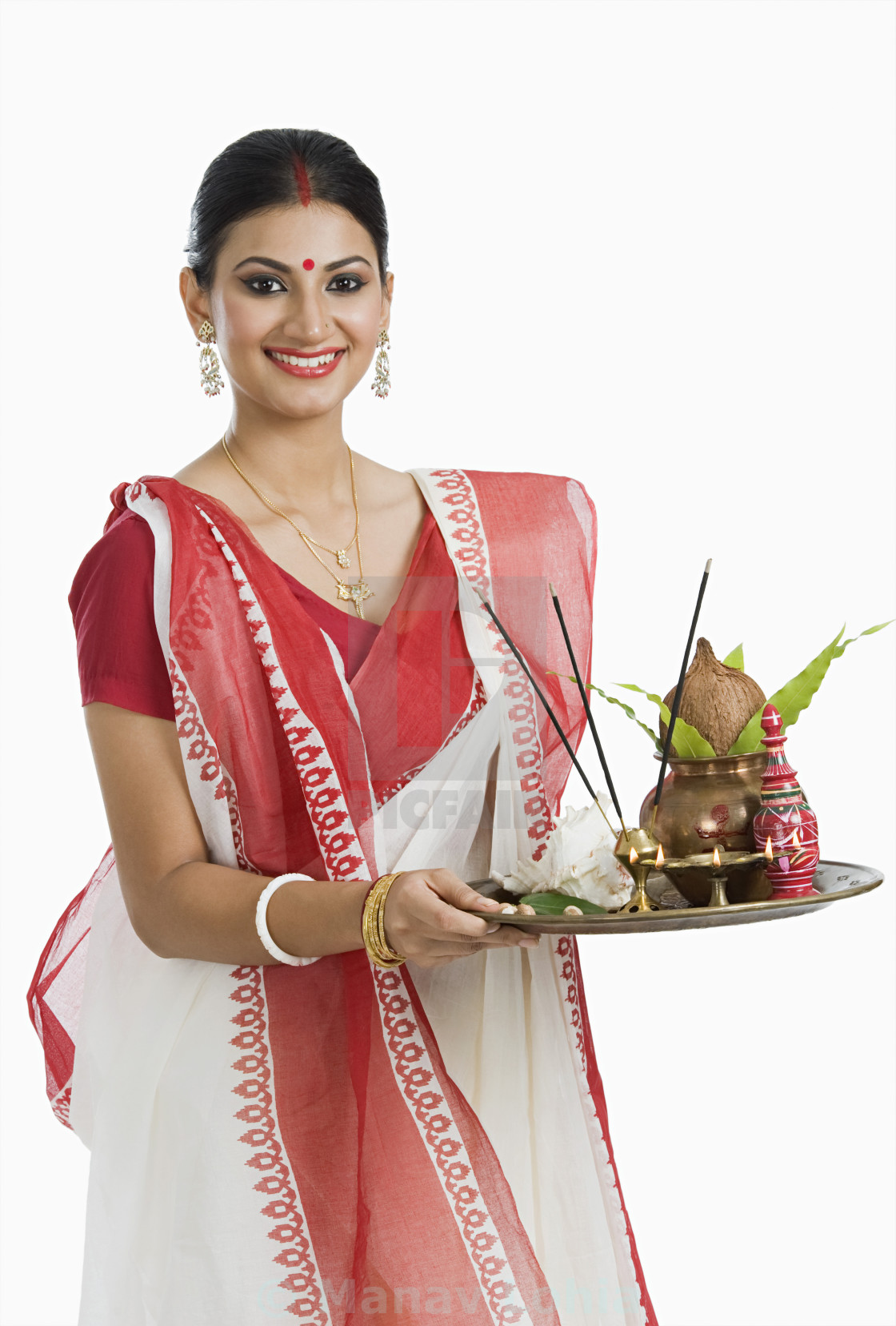 Bengali woman holding a puja thali - License, download or