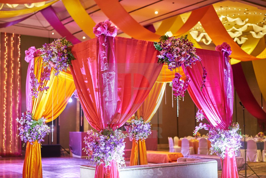 Colorful stage decoration for bride and groom in sangeet night of ...