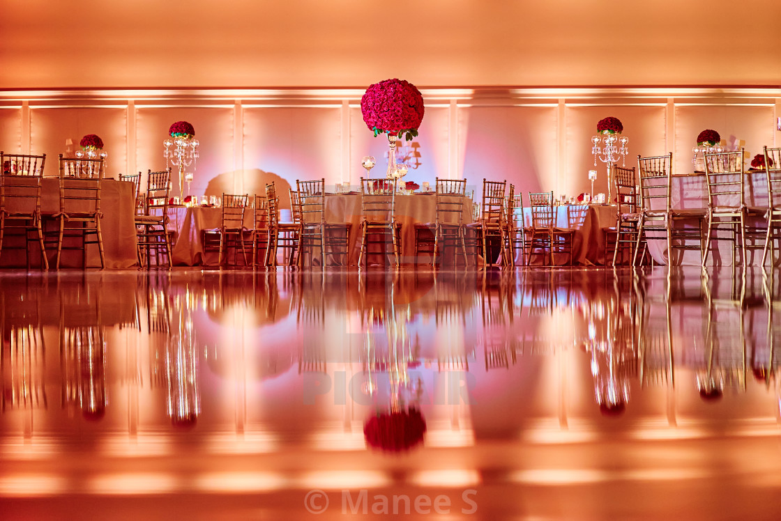 The reflection of wedding reception dinner table decoration with ...