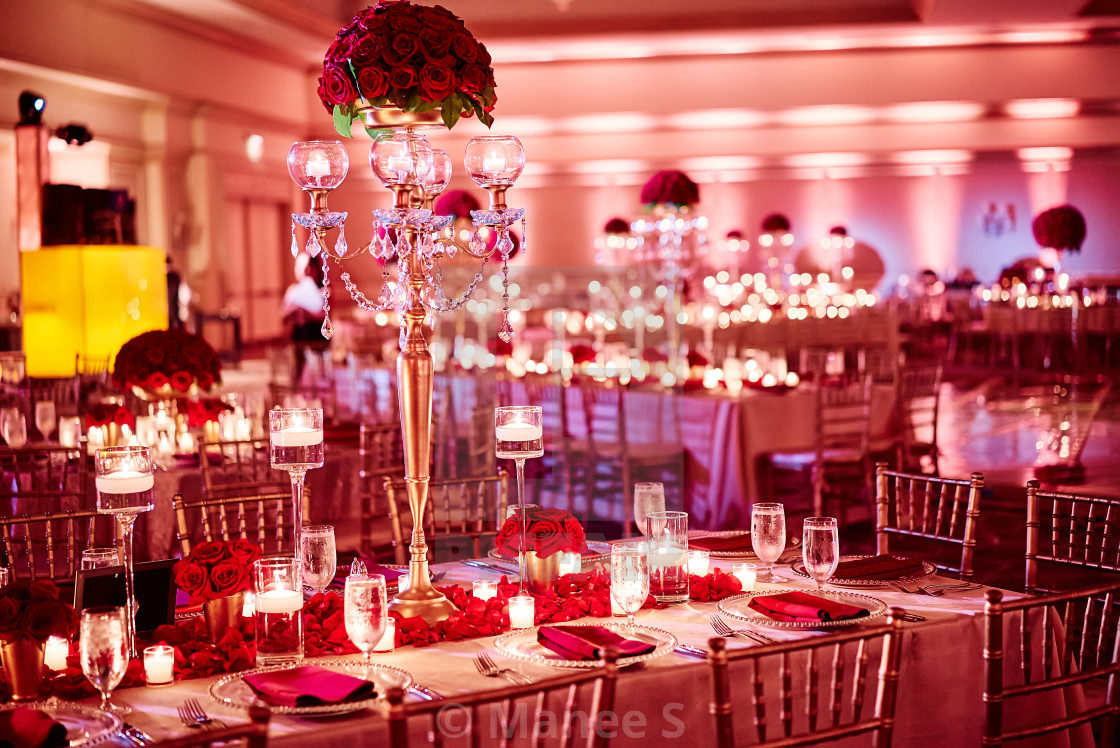 Luxury Indian wedding reception dinner table decoration with red ...