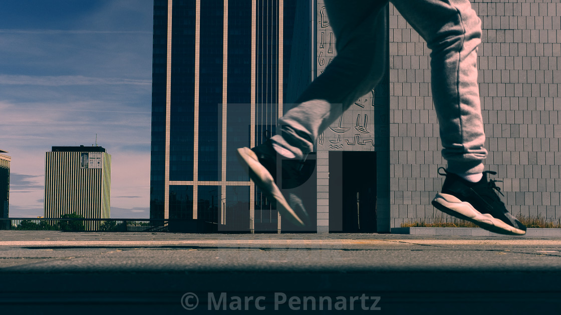 """Boy Jumping Outside Office Buildings Brussels"" stock image"