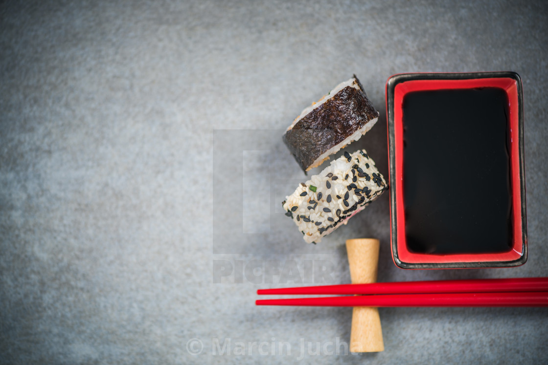 """Chopsticks and soy sauce on stone concrete board"" stock image"