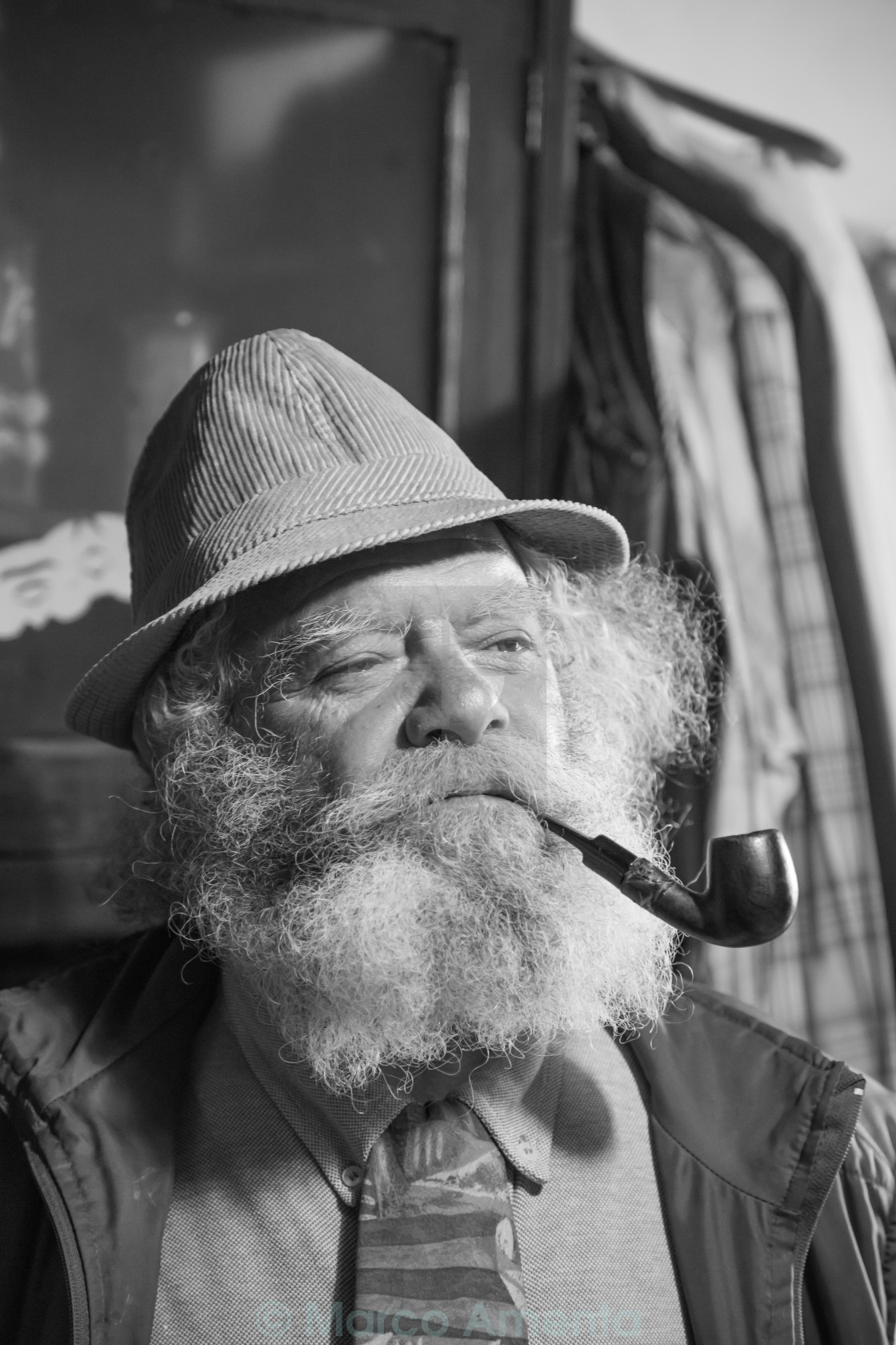 """portrait of a cute old man with a long beard smoking a pipe"" stock image"