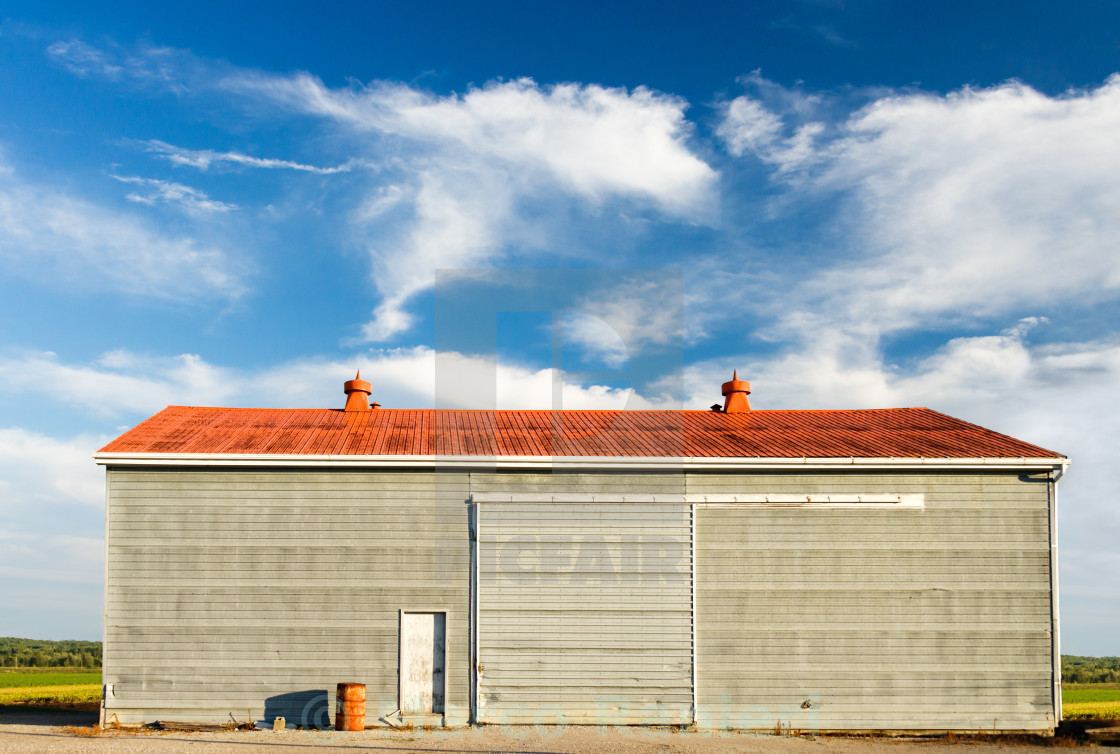 """Blue Sky, Red Roof"" stock image"