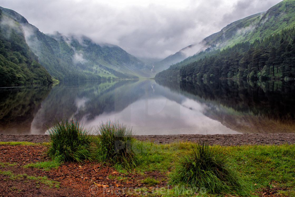 """Glendalough Lake with clouds"" stock image"