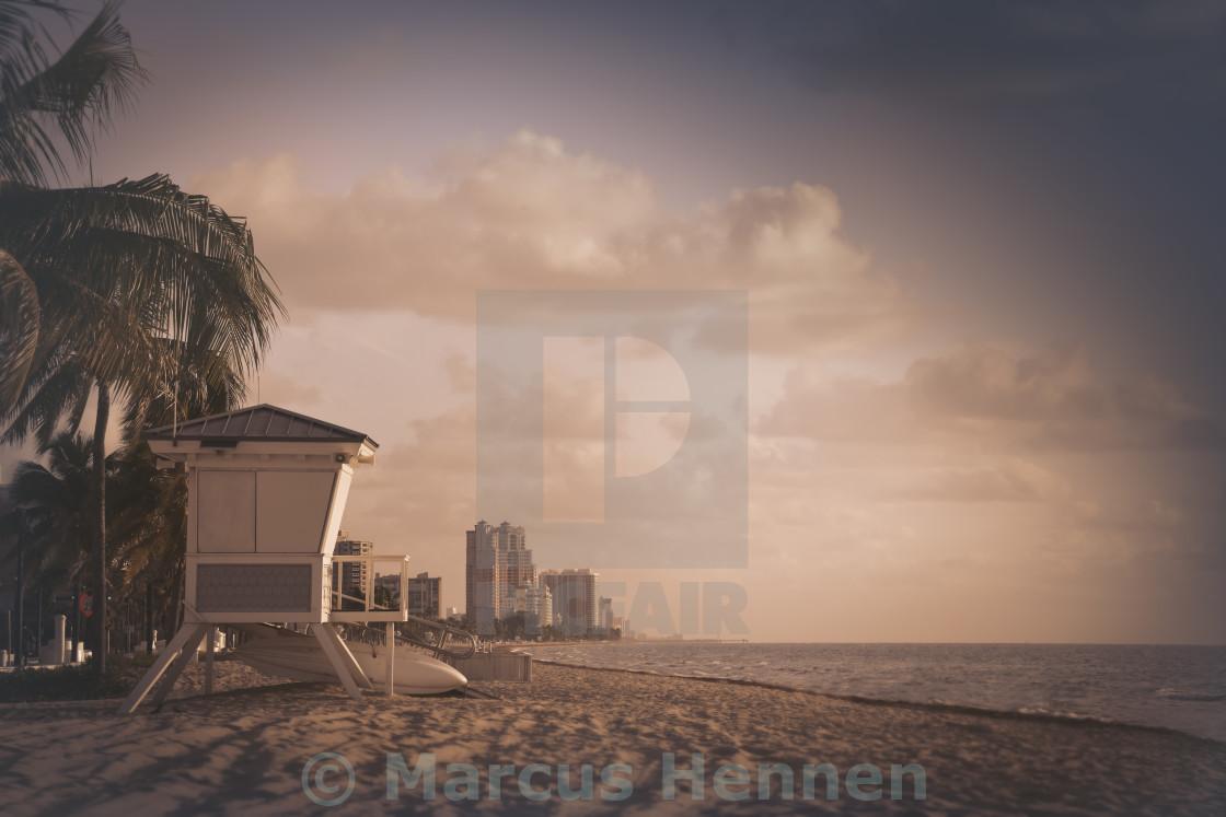 """Beach life at sunrise"" stock image"