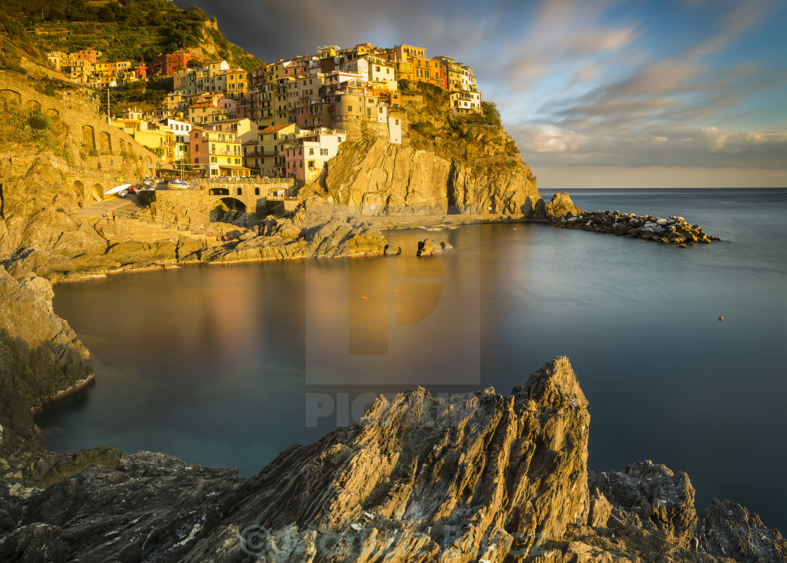 """Manarola illuminated by the setting sun"" stock image"