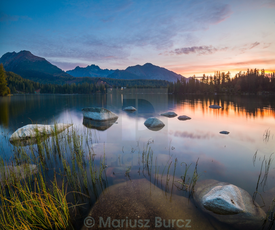 """The sunrise over a lake in the park High Tatras. Shtrbske Pleso,"" stock image"