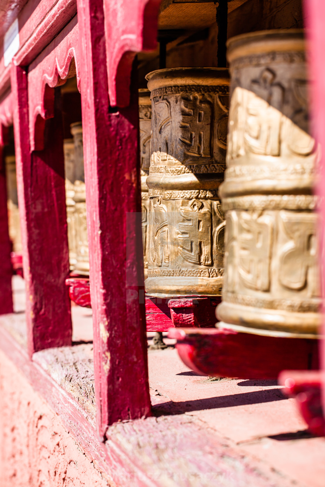 Buddhist prayer wheels in Tibetan monastery with written