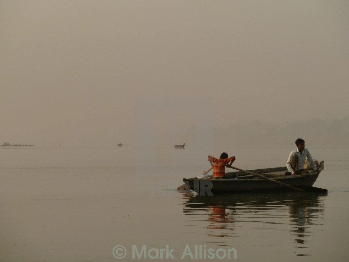 """""""Boy rows down the Ganges"""" stock image"""