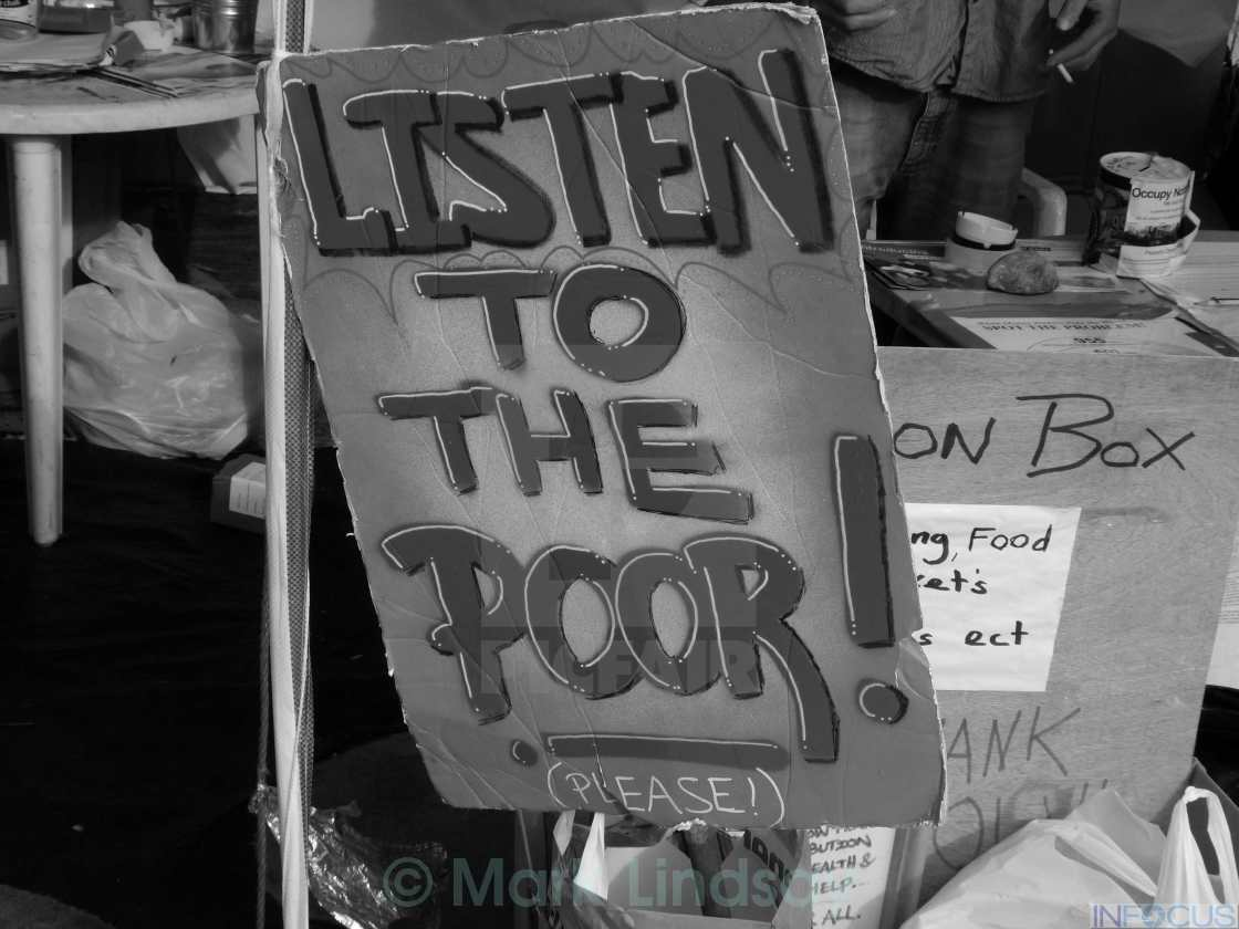 """Listen to the poor !"" stock image"