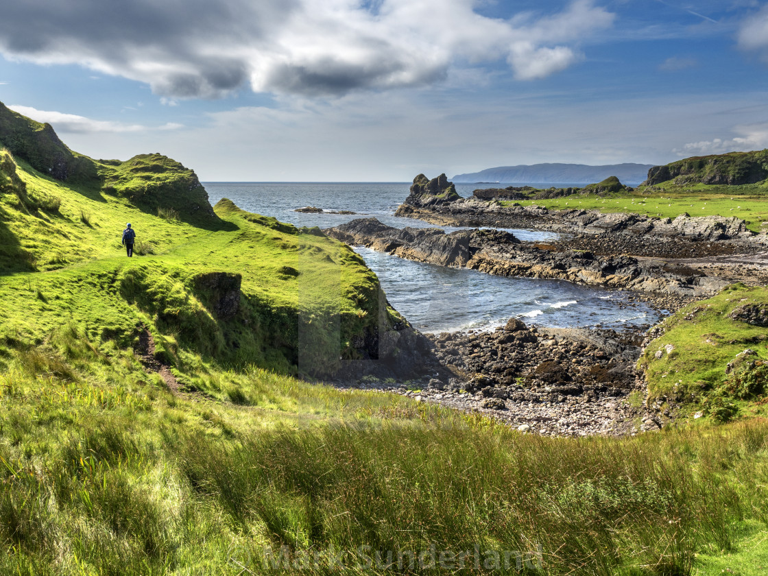 """Lone Walker at Port a Chaisteil on Kerrera"" stock image"