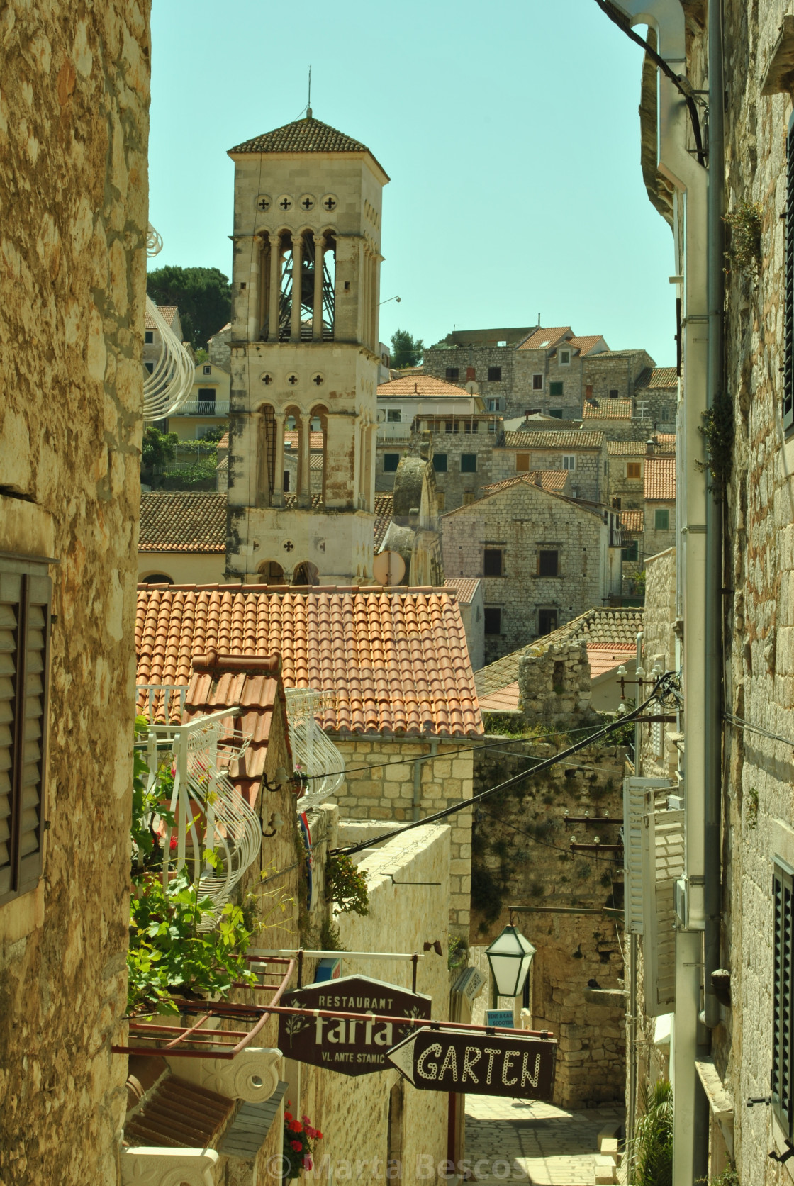 """Narrow stone street in Town of Hvar"" stock image"
