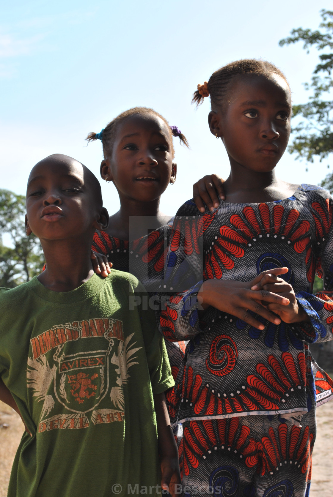 """""""Group of children pose for the tourist in the street in Carabane-Senegal."""" stock image"""