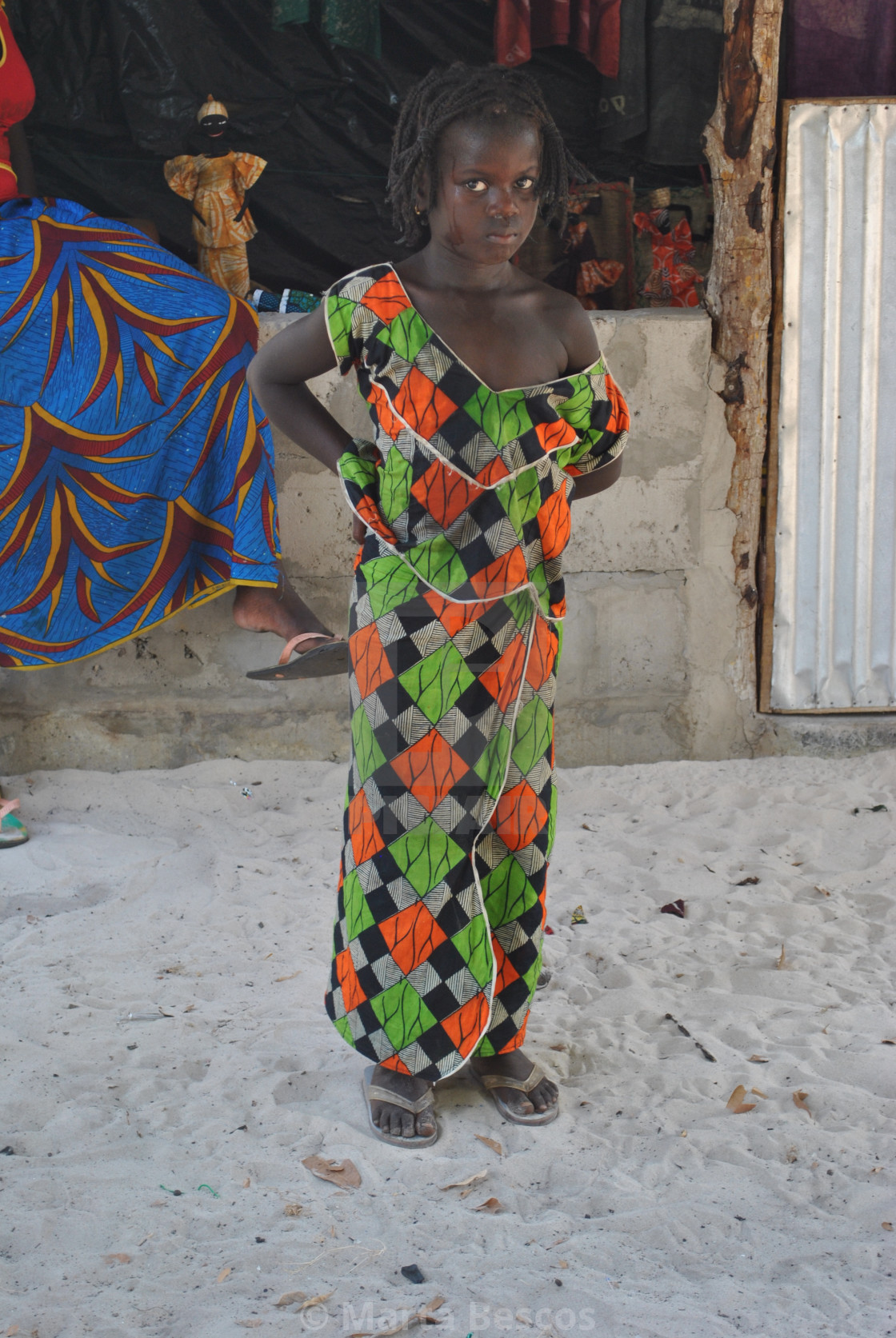 """""""Beautiful girl poses for the tourist in the street in Carabane-Senegal."""" stock image"""