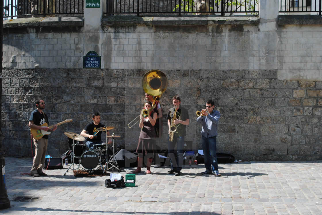 """Street musicians play in Place des Abbesses, in the Montmartre district of Paris, France"" stock image"