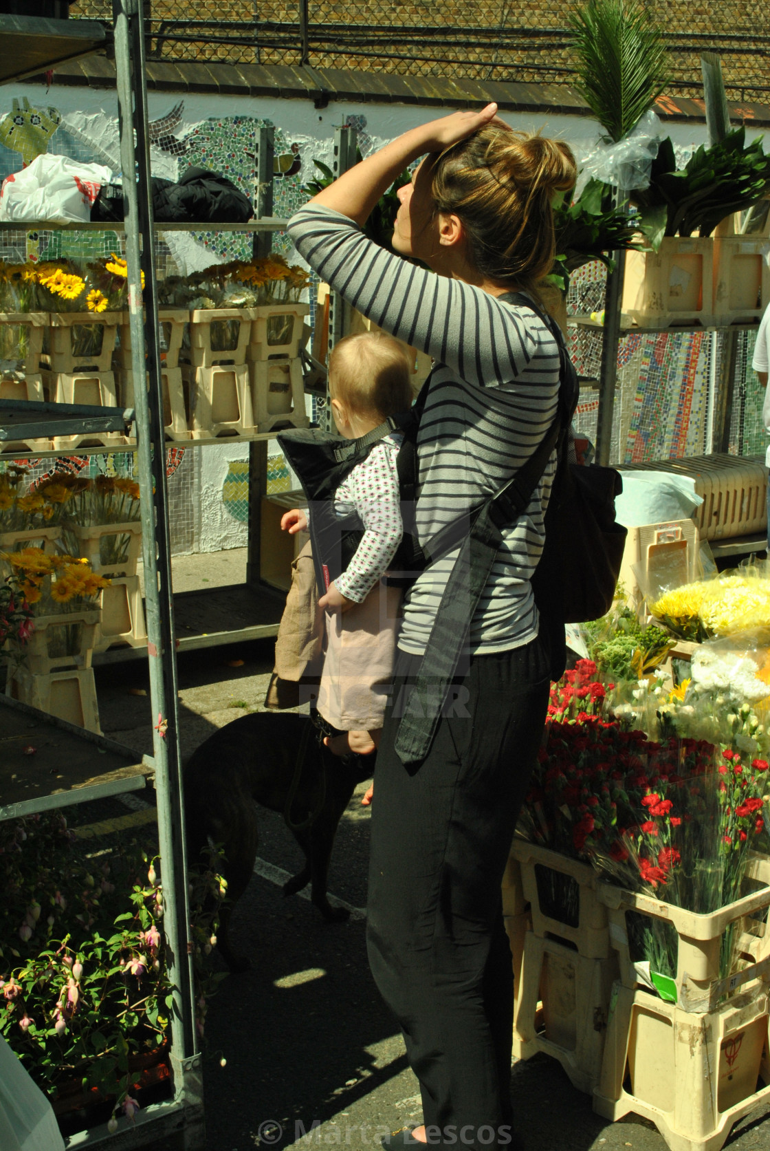 """""""A woman with child buying flowers at columbia road flower market in east london"""" stock image"""