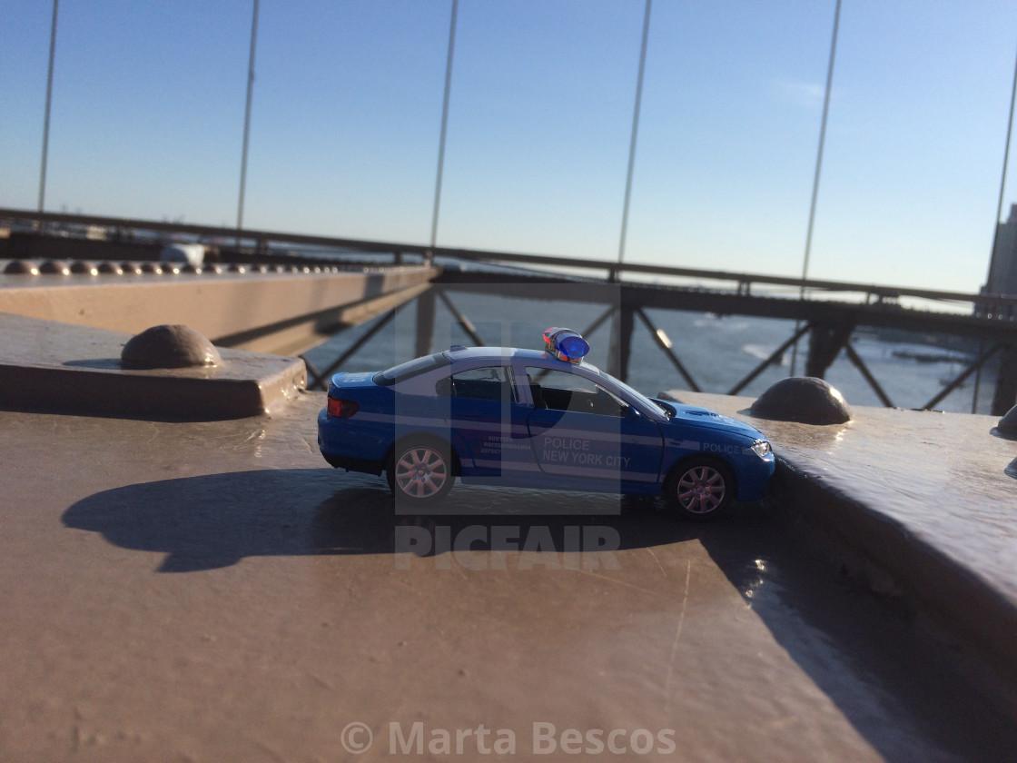 """Policer car miniature at Brooklyn Bridge, NYC, USA."" stock image"