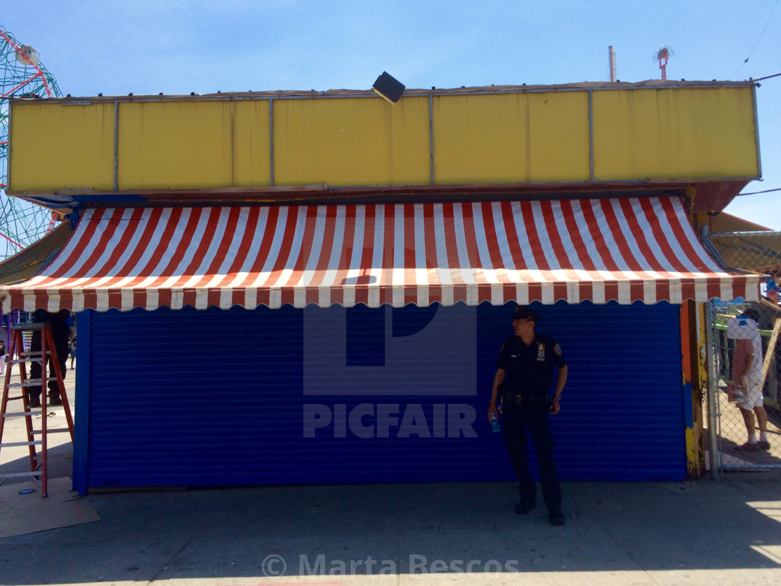 """""""New York city policeman on patrol in the coney island area of NYC"""" stock image"""