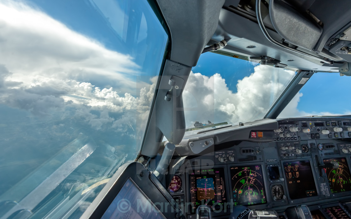 """Navigating around clouds"" stock image"
