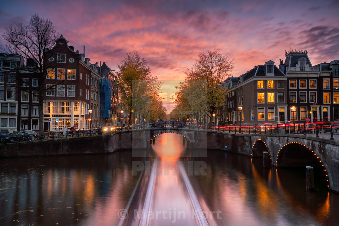 """Amsterdam canals at sunset"" stock image"