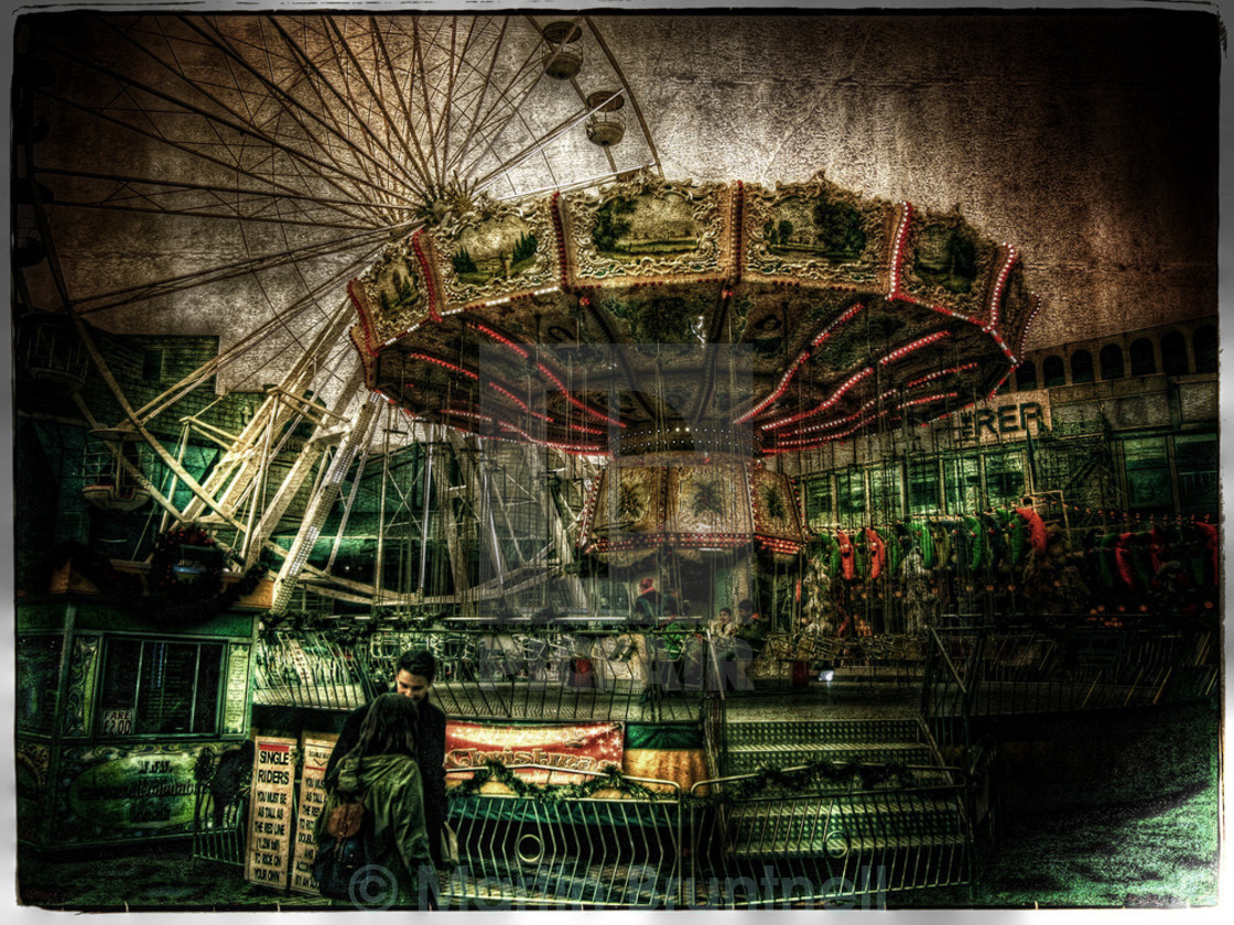 """The Ferris wheel and Carousel."" stock image"