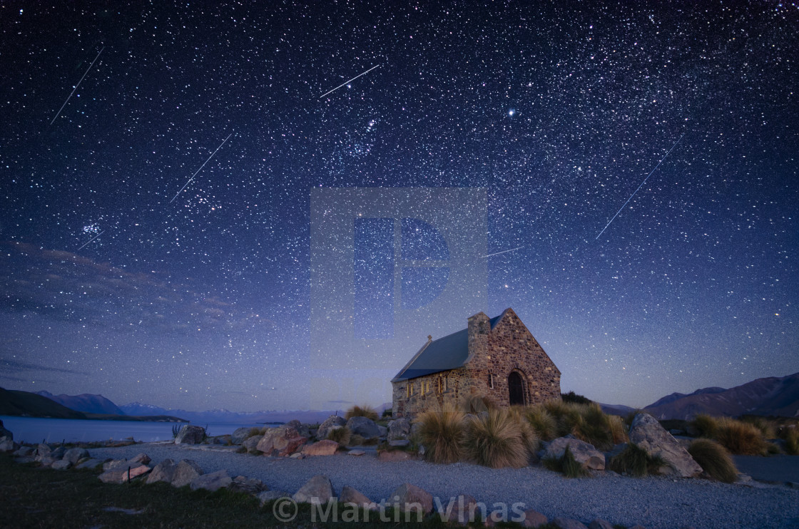 """Night sky over Good Shepherd's Chapel, Lake Tekapo, New Zealand"" stock image"