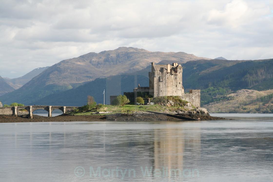 """Scottish castle on loch"" stock image"