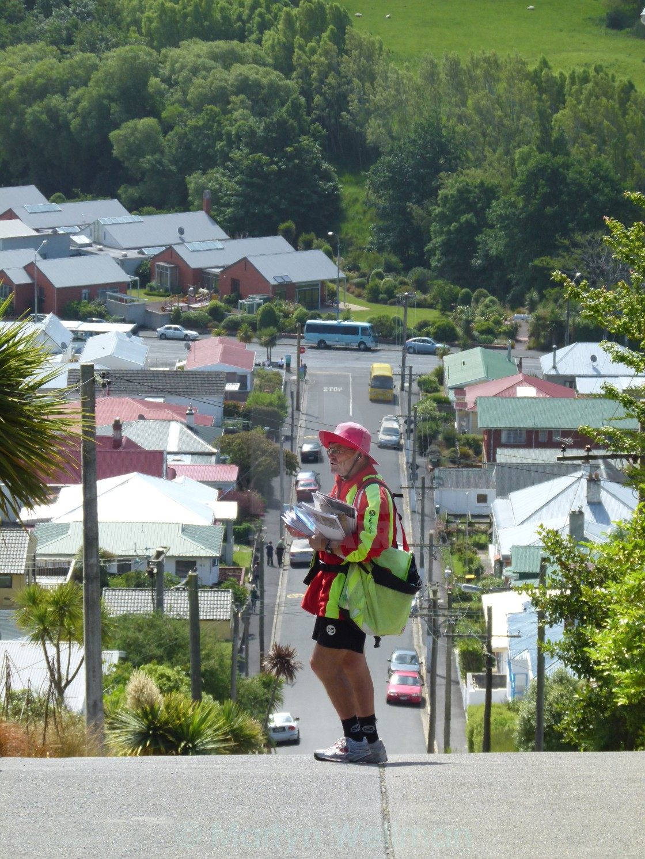 """Postman on steep street, NZ"" stock image"