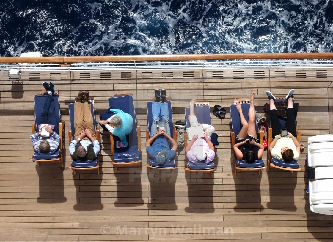 """Sunbathing on deck (version 1)"" stock image"