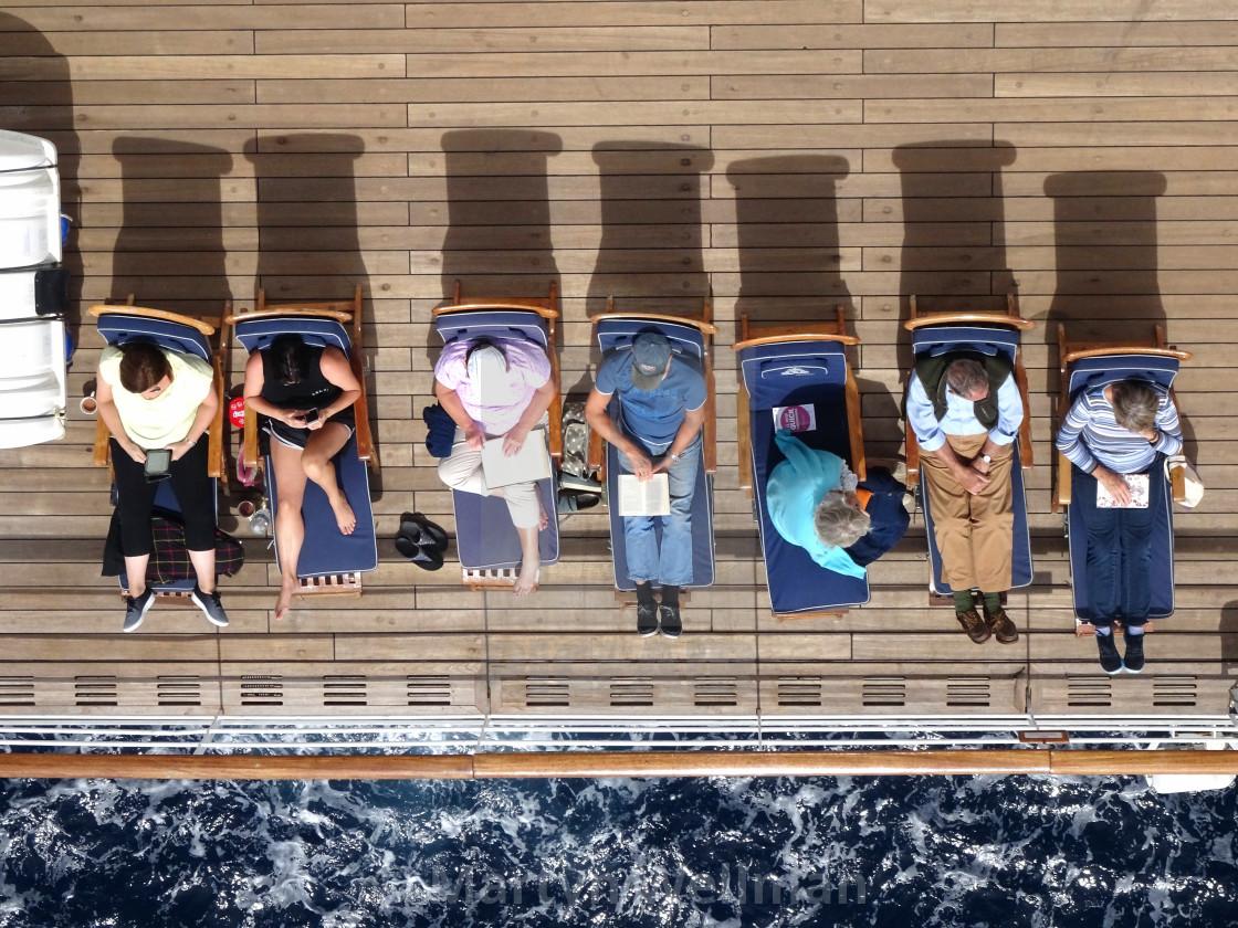 """Sunbathing on deck (version 2)"" stock image"