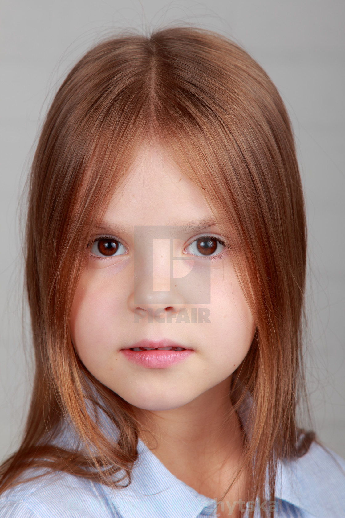 """""""Close-up portrait of a beautiful little girl with long brown hair"""" stock image"""