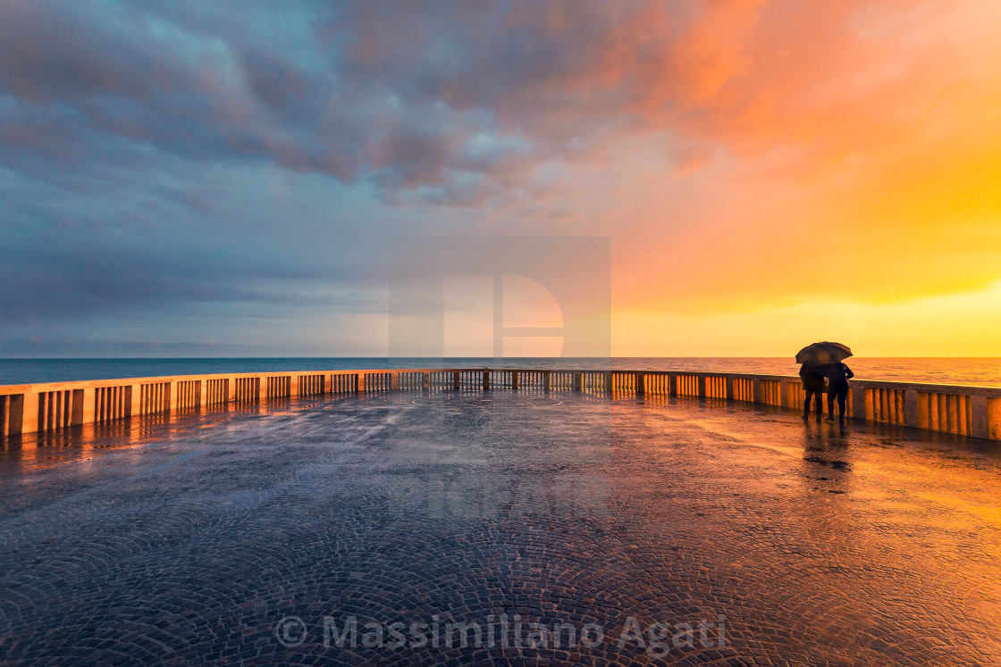 """The natural spectacle of a splendid sunset while it is still raining"" stock image"