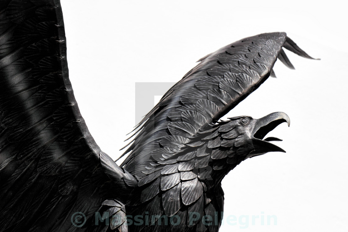 """Detail of the metal sculpture of an eagle"" stock image"