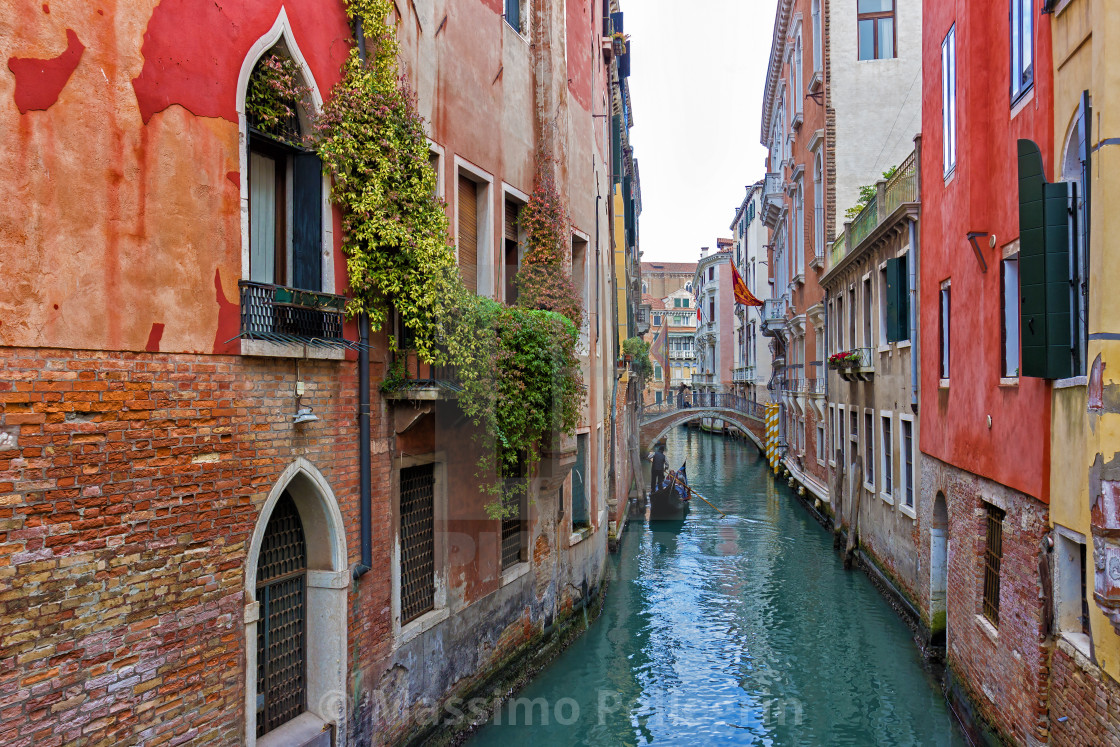 """Typical Venice canal with gondola"" stock image"