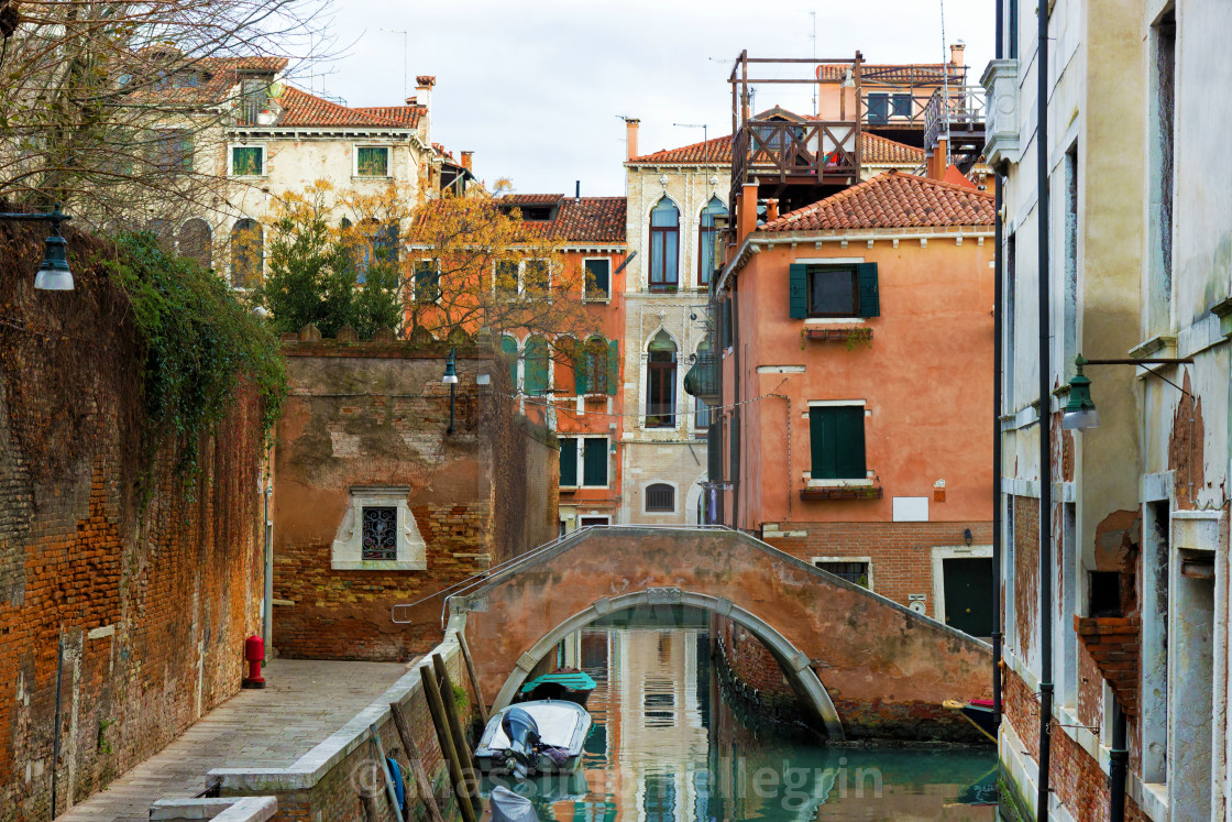 """""""Typical Venetian canal with bridge"""" stock image"""