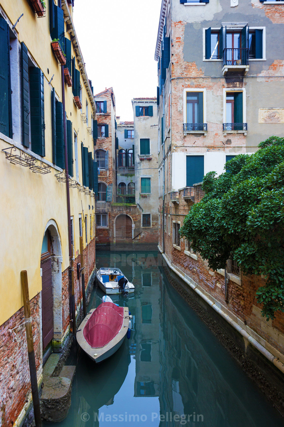 """""""Typical Venice canal with moored boats"""" stock image"""
